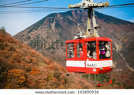 NIKKO, JAPAN - NOV 5: People taking on the cable car to see the top view of Nikko city and the famous waterfall on the mountain on November 5, 2011.