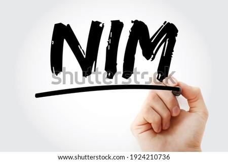 NIM - Net Interest Margin acronym with marker, business concept background Foto d'archivio ©