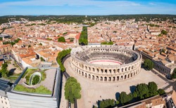 Nimes Arena aerial panoramic view. Nimes is a city in the Occitanie region of southern France