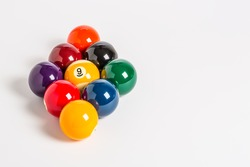 Nine Ball racked in a diamond shape on a plain white background left side.