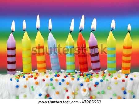 Nine birthday candles on colorful background