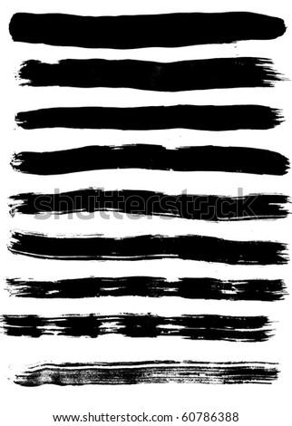 Nine black silhouettes of traces of brush isolated on white background