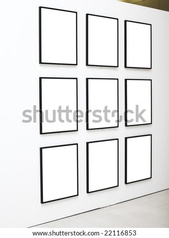 Nine empty frames on white wall exhibition in Museum - stock photo