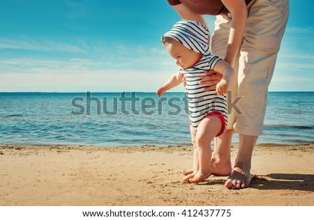 nine month old baby boy walking ...