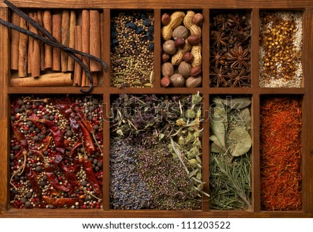Nine Sections in Wooden Box with Mixed Spices, Herbs and Dried Leafs close up