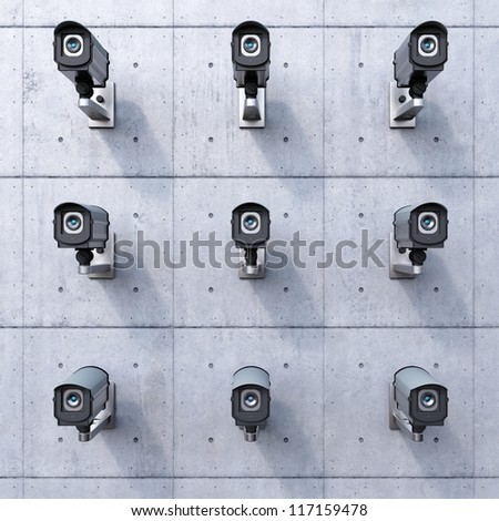 nine security cameras on a concrete wall
