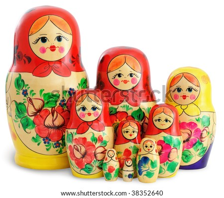 Nine traditional wooden Russian dolls arranged in group. Isolated on white background. - stock photo