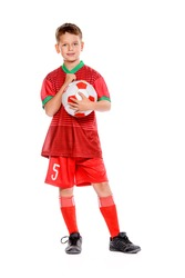 Nine year old boy football player in his uniform with a soccer ball. Full length portrait. Isolated over white.