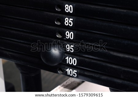 Ninety-five kilograms weight set on a training machine. Pull strength training equipment. Close view.
