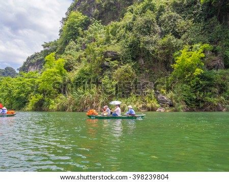 NINH BINH - MAY 22: Cruise tour boats at Trang An Scenic Landscape Complex in Ninh Binh Province, Vietnam on May 22, 2015. It was inscribed as a UNESCO World Heritage Site on June 23, 2014.