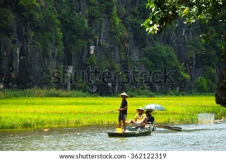 NINHBINH, VIETNAM - MAY 9, 2012: Boats for travel in Tamcoc eco tourism, Ninh Binh, Vietnam.