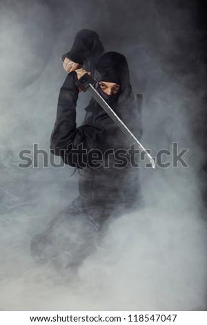 Ninja defending with sword - stock photo