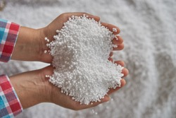 Nitrogen fertilizers or urea fertilizer in farmer hand. blur