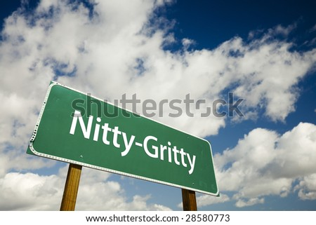Nitty-Gritty Road Sign with dramatic clouds and sky. - stock photo