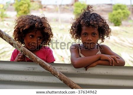 NIVANI ISLAND, PNG - JULY 28: Unidentified melanesian children of Papua New Guinea. July 28, 2009, Nivani Island, Papua New Guinea