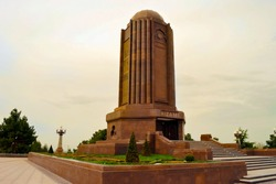 Nizami mausoleum .The tile is renewed with 20 m high cylindrical form of marble building and surrounding park. The first tomb was built in the 13th century. Azerbaijan, Ganja, 12 september 2017.
