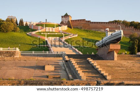 Nizhny Novgorod city, Russia. A panoramic view of the Chkalov Staircase and the ship 'Hero' on the background of the Novgorod Kremlin, in the sunset light. Сток-фото ©