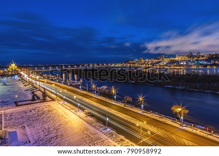NIZHNY NOVGOROD, RUSSIA - Panoramic view of historical part of Nizhny Novgorod with Cathedral of St. Alexander Nevskiy and bridge over river Oka in evening time on 8 January 2018 #790958992
