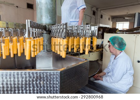 NIZHNY TAGIL, RUSSIA - APRIL 24, 2015: Automatic production line of fruit ice and ice cream