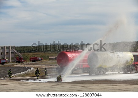 NIZHNY TAGIL, RUSSIA- AUG 23: Demonstration of work of firemen, the fire was extinguished by the railway at the exhibition RUSSIAN DEFENCE EXPO 2012 on August, 23, 2012 in Nizhny Tagil, Russia