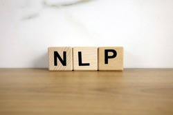 NLP neuro linguistic programming abbreviation from wooden blocks, business success concept