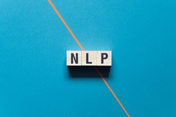 NLP - Neuro Linguistic Programming word concept on cubes