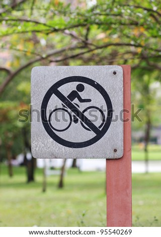 No bike riding sign in the park
