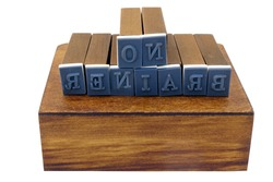 NO BRAINER concept spelled out with rubber stamp blocks in reverse. Isolated.