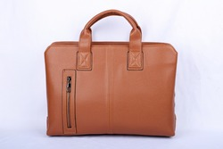 No brand brown natural leather bag isolated on white background. Accessory for men.