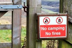 No camping, no fires warning sign