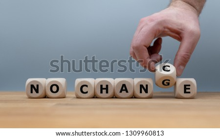 """No change, no chance. Hand turns a dice and changes the expression """"no change"""" to """"no chance"""""""