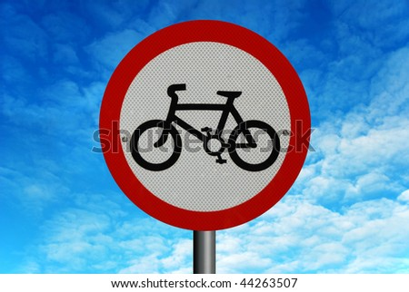 No Cycling road sign, against a background of a bright blue summer sky.