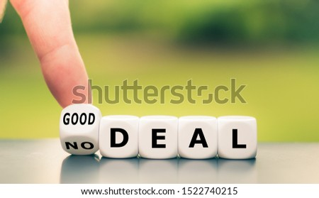 """No deal or good deal? Hand turns a dice and changes the expression """"no deal"""" to """"good deal"""", or vice versa."""
