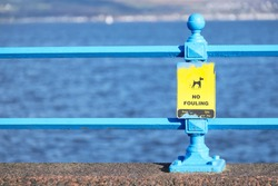 No dog fouling sign at beach esplanade by the sea