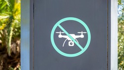No drone sign at a public park in Spain. No drone zone pictogram, prohibition and caution. prohibited flying drones or remote-controlled aircraft. restriction and notice sign.