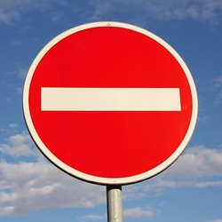 No entry for vehicles traffic sign against blue sky