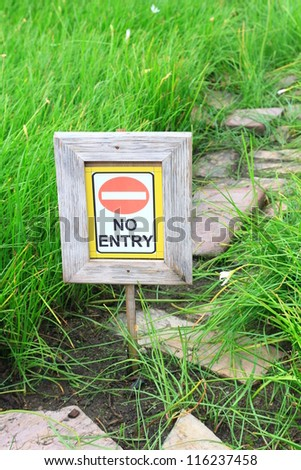 no entry sign with tree and grass background