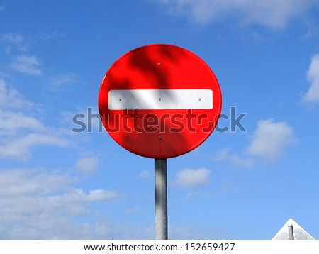 No entry traffic sign with blue sky background.