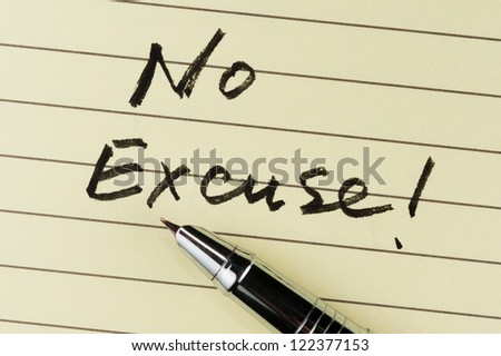 No excuse words written on lined paper with a pen on it