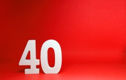 No 40 ( Fourty ) Isolated red  Background with Copy Space - Number 40 Percentage or Promotion - Discount or anniversary concept