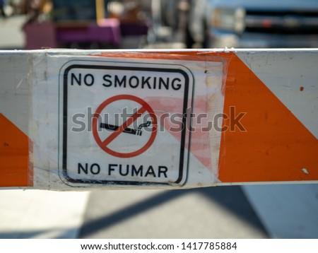 No fumar no smoking sign symbol sign posted on barricade #1417785884