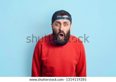 No! Goal! Emotionally yelling young bearded man looking with astonishment and open mouth into camera, being amazed with negative news, isolated on light background. Emotional hipster guy expressing su #1314119285