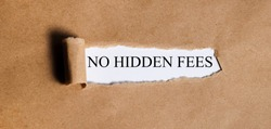 no hidden fees. Text on white paper on torn paper