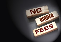 No hidden fees word written on wood block. Taxes and fees Financial business concept.