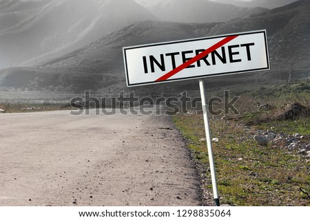 """No Internet connection concept. Road and road sign crossed out word """"INTERNET""""."""