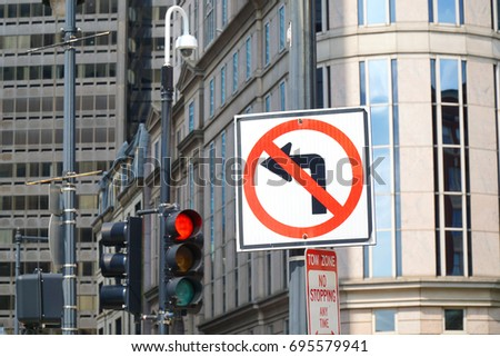 no left turn sign on the street