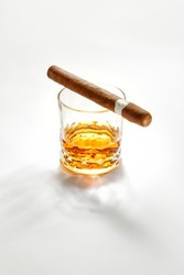 NO LOGOS OR TRADEMARKS!  SELF MADE LABELS! Closed up view of glass of whiskey with cigar on top on white back