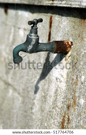 No more water from this tap, disused water tap on a wall ready for condemnation. #517764706