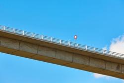 No overtaking traffic signal on a bridge. Caution