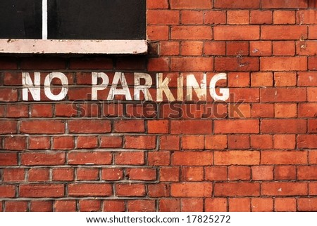 No parking lettering on brick wall